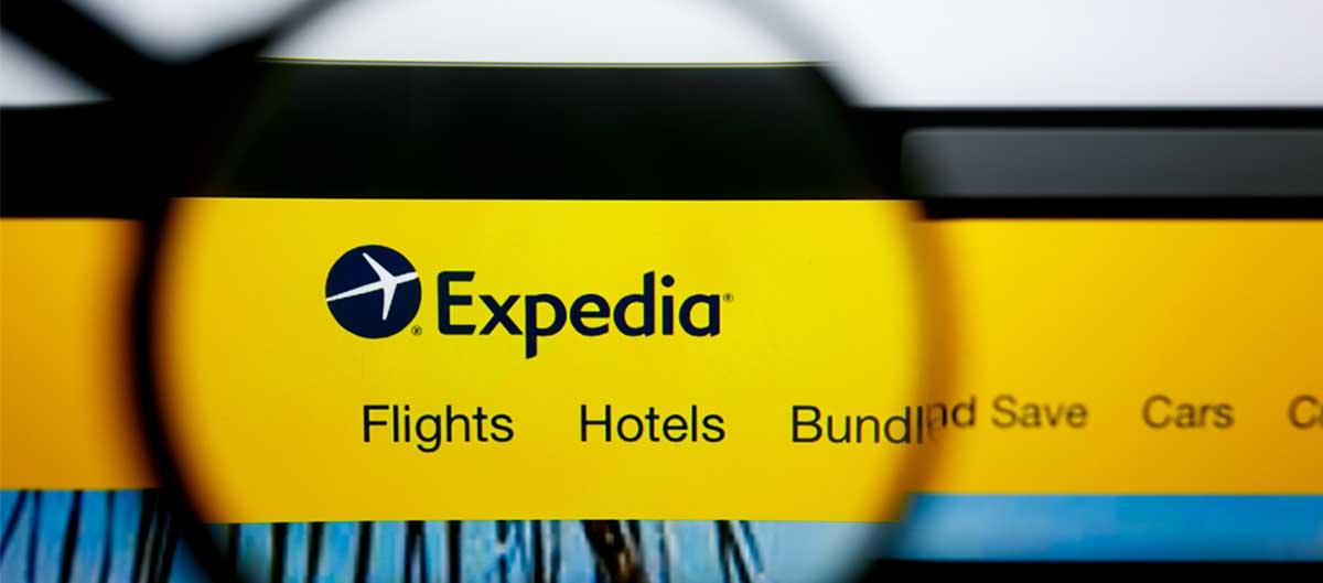 expedia agence site internet avec loupe logo